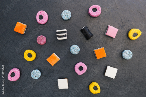 Liquorice allsorts candy sweets dark background Wallpaper Mural