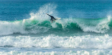 Surfer Riding Crest Of Wave, F...