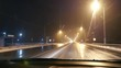 Night car traffic on the wet slippery snow road. Bad weather. Truck on the opposite lane. Headlights and street bright lighting . Road safety