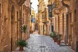 Walking cobblestone street in Birgu city, Malta