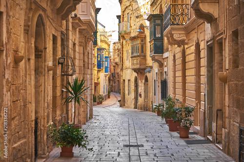 Fototapeta Walking cobblestone street in Birgu city, Malta obraz