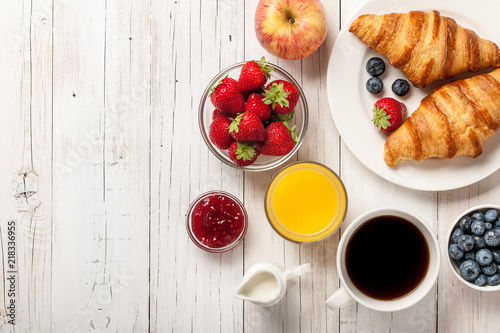 Stampa su Tela Breakfast with croissants, coffee, jams and berries