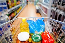 Inside View Of Shopping Cart Full Of Groceries With Motion Blur