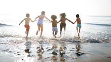 Group Of Kids Enjoying Their Time At The Beach