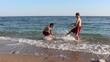 Boys Having Fun With Water In The Sea