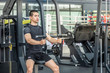 Young sport man exercising in fitness gym