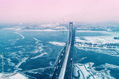 Skyline, Kiev city in the blizzard in the early morning. Aerial view from the left bank of the Dnieper River at The Pivdennyi (Southern) Bridge
