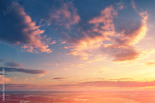 Obraz Cloudy sky at sunset. Evening in countryside - fototapety do salonu