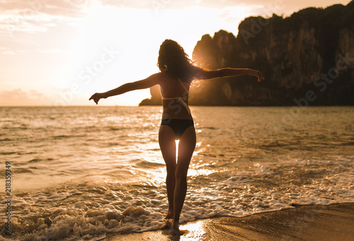 Young girl in bikini posing and smiling on a beach of Thailand