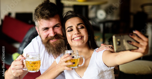 Vászonkép Couple in love on date drinks beer