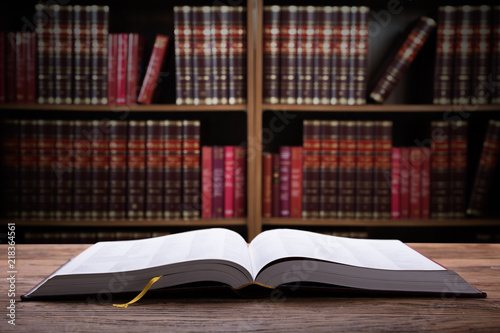 Fotografie, Obraz Close-up Of An Open Law Book