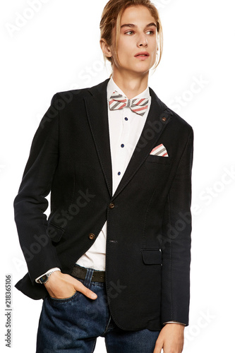 70f85ebb06 An elegant young man in a black suit jacket and button up shirt,  accessorized with a striped bow tie and pocket square. The blond guy  looking aside over the ...