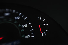 Close Up Of Gas Gauge On Empty In A Car.