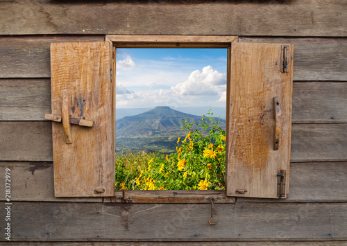 View of old vintage wooden windows, wooden frame of rural landscape