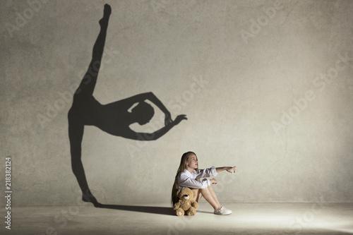 Fotografie, Obraz Baby girl dreaming about dancing ballet