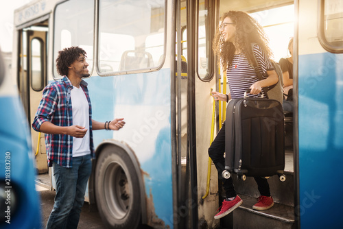 Fotografia  Young Afro-American boy is happy to see his girlfriend arriving back home
