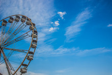 Entertainment Carnival Concept Of Ferris Wheel On Blue Sky Cloud Background With Empty Space For Copy Or Text