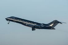 Black Modern Private Business Jet Taking Off