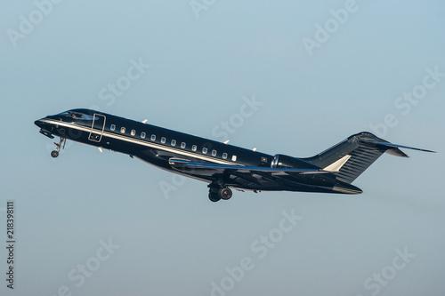 Fotografie, Tablou Black modern private business jet taking off