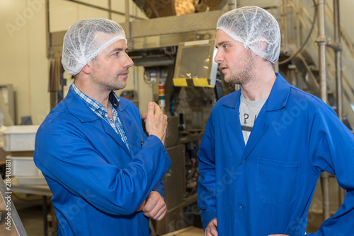factory workers with hairnet Canvas Print