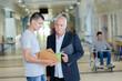 male student seeking advice from a teacher