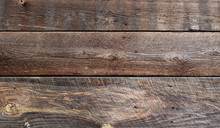 Unfinished Barn Board Siding Showing Weathering, Grain, Knotholes And Years Of Abuse