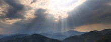 Rays Of Sunshine Abstract Graphic Resource. Panoramic Mountains, Clouds And Bright Rays Of Light Shining Through An Opening In The Clouds. Sign From Heaven Concept, Brilliant Light From Above.