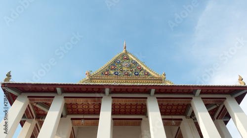 Spoed Foto op Canvas Bedehuis top roof of thai church and building of Thai temple. colorful golden roof at Thai temple in Thailand. sky background