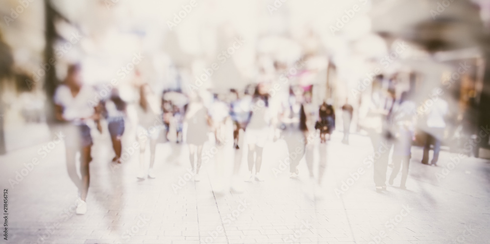 Fototapeta Crowd of anonymous people walking on busy city street, urban city life background