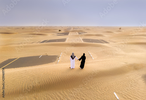 emirati couple in a desert