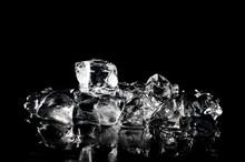 Fresh Ice Cubes Melting On The Dark Background
