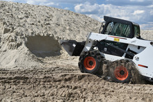 Skid-steer Loader Working With...
