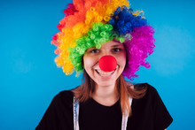 Girl In A Bright Image Of A Clown. Emotional Portrait Of A Student. Costumed Presentation Of Children's Animator. Female Clown