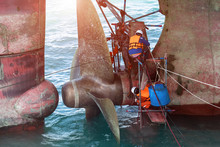 Repairing And Replacement Of Shaft On Propeller Of The Ship In Medsea Port Terminal By The Workers And Technician