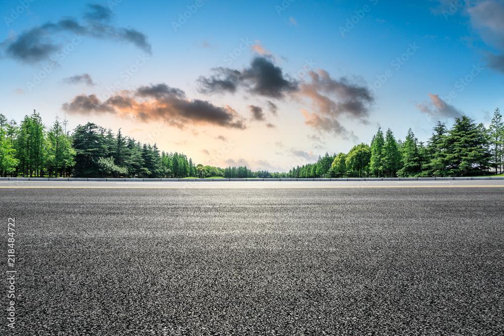 Fototapety, obrazy: Empty asphalt road and green forest landscape at sunrise