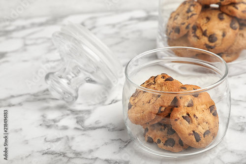 Fotografie, Obraz Jar with chocolate chip cookies on marble background, space for text