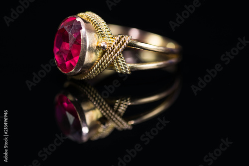 Real gold ring with red gem close up macro shot