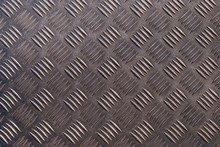 Dark Shining Metal Floor Surface With Industrial Diamond Plate Relief Pattern