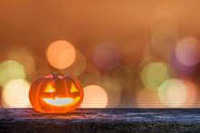 Halloween Pumpkin Jack O'Lantern Happy Smiling Face On Grunge Wood Night Bokeh