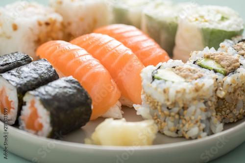 Fotografie, Tablou  Salmon and tuna sushi mix plate with Nigiri, Maki and inside out California roll