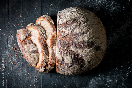 Top view of delicious loaf of bread with flour