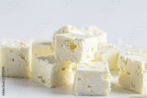 Feta cheese cubes isolated on white background