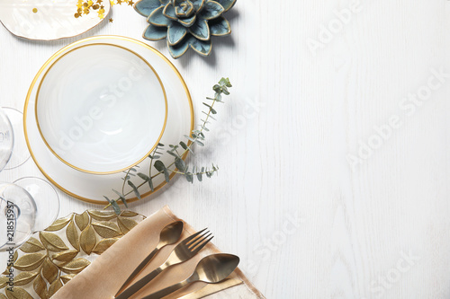 Elegant table setting and space for text on light background, top view