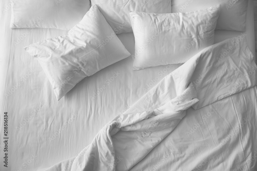 Fototapeta Soft pillows on comfortable bed, top view