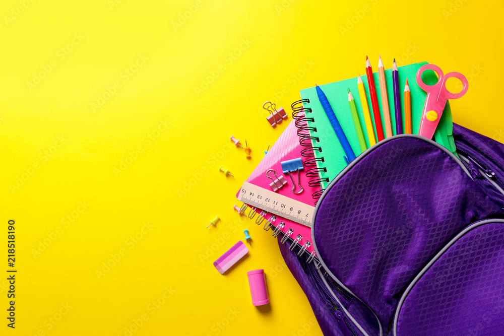 Fototapety, obrazy: Flat lay composition with backpack and school stationery on color background