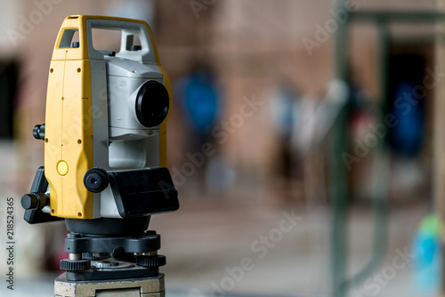 Poster Retro engineer site survey with laser tripod machine in site construction background