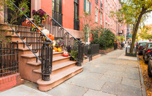 Pumpkins, Flowers, And Halloween Decorations On Steps In West Village, New York