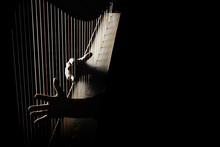 Harp Player. Hands Playing Irish Harp Strings