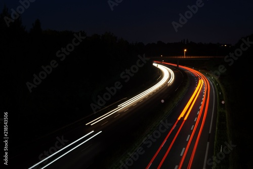Foto op Canvas Nacht snelweg Automobile light trails, night traffic on the highway, city landscape. Picture taken with long exposure shooting