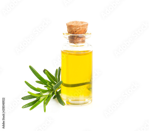 Fototapeta rosemary oil on wooden surface obraz